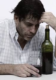 No offense, stock photo people, but this dude ain't a real alcholic - the cork is still in the bottle.  Jeez.